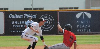 Milam is tagged out just as he slides onto the base