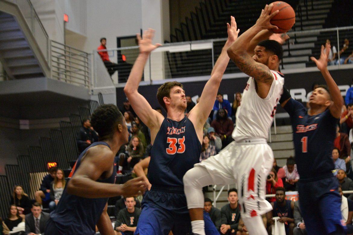 CSUN Senior, Aaron Parks jumping through Fullerton players to make a lay up at the game on Saturday, March 4. Photo credit: Breaunne Pinckney