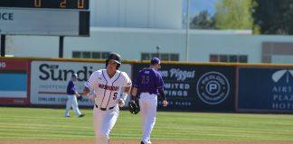 CSUN baseball player runs to third base