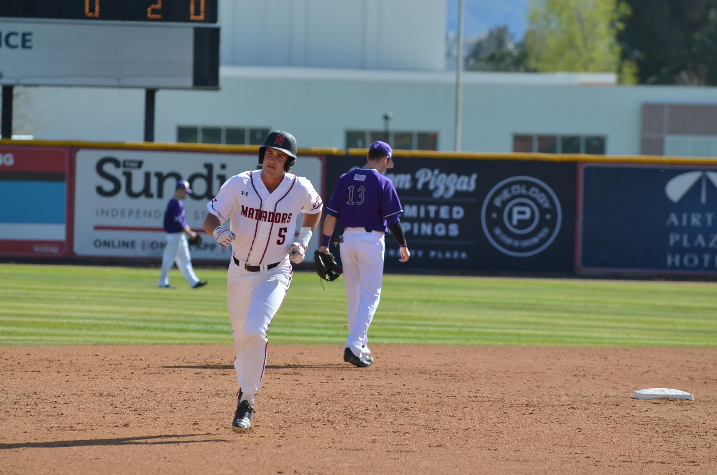 Junior third baseman Nolan Bumstead, #5, runs to third base after hitting a home run in the bottom of Wednesday's game against Holy Cross on March 8, 2017. Bumstead's homerun brought the Matadors to a lead of 2-0. Photo Credit: Anthony Martinez/The Sundial