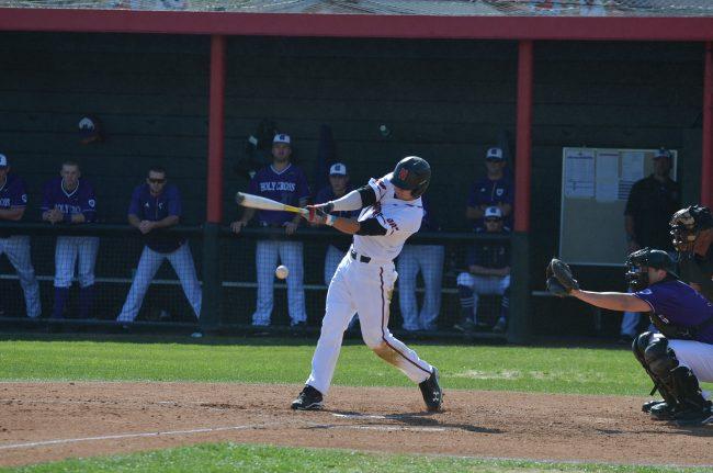 csun baseball player hits the ball
