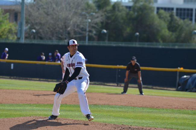 csun baseball player prepares to throw the ball