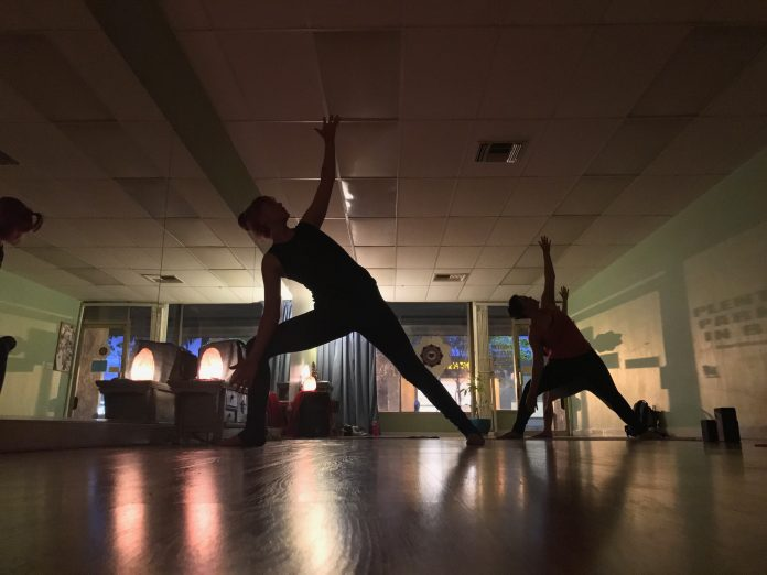 Two women participate in a yoga session