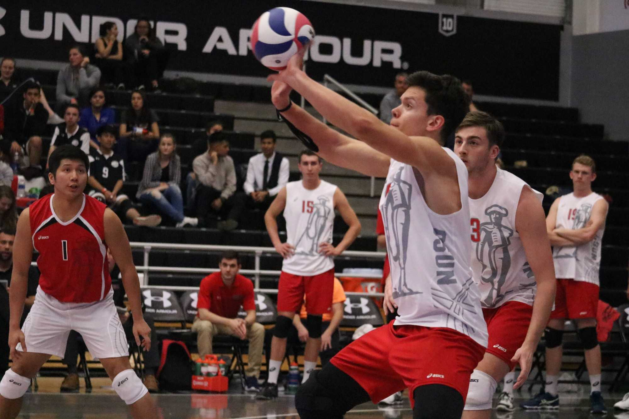 CSUN's sophomore outside hitter, Dimitar Kalchev sets the ball on Wednesday night's game against UC San Diego, on March 1, at the Matadome. Photo credit: Lauren Valencia