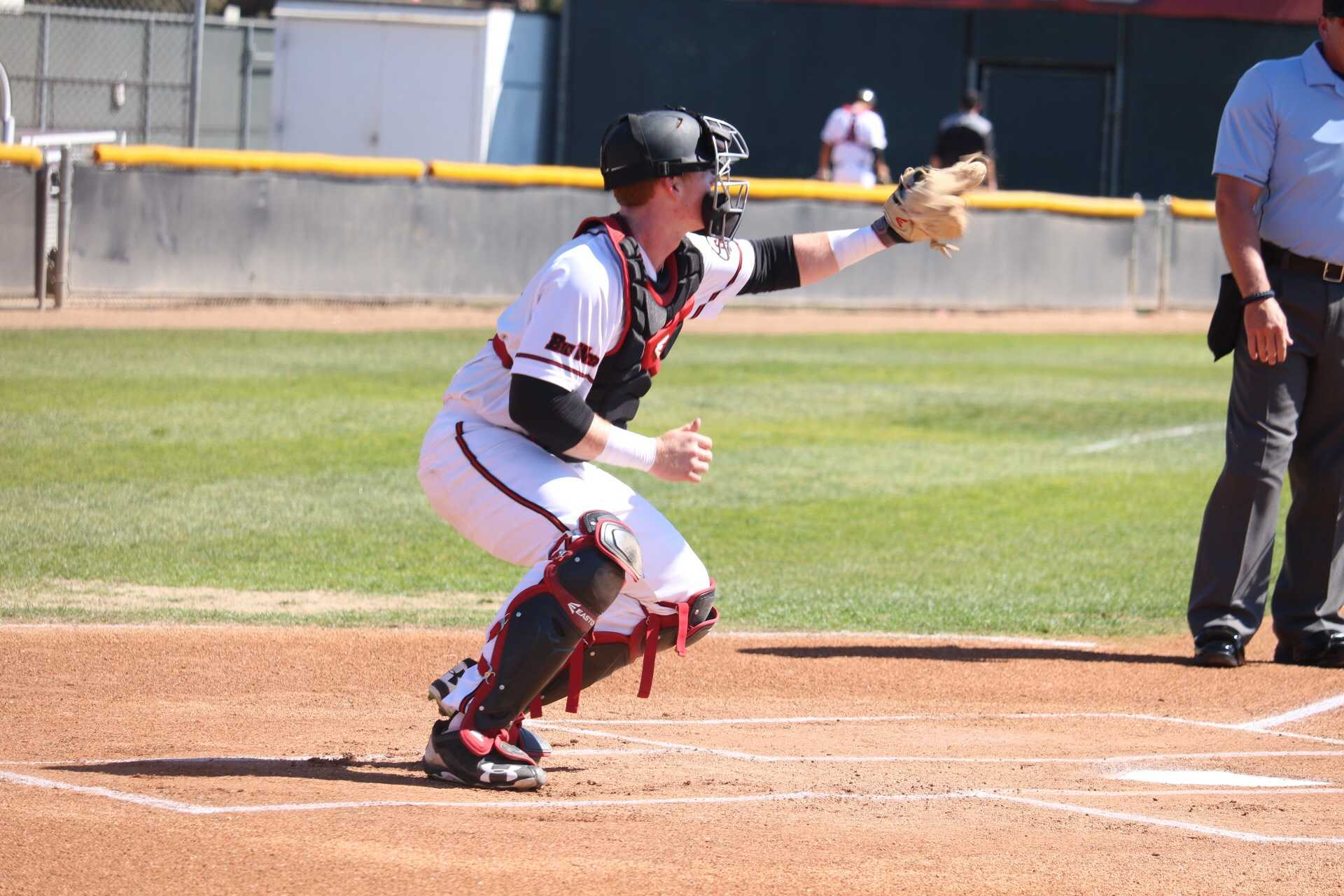 CSUN's junior catcher, Albee Weiss, practices before the game against the Purdue Boilermakers, on Monday, March 13, at the Matador Field. Photo credit: Lauren Valencia/ The Sundial