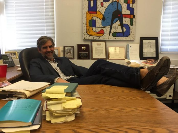 Professor Dungey pictured in his office with his feet rested on his desk