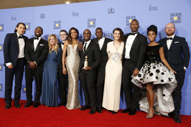 photo shows many of the actors at the golden globes