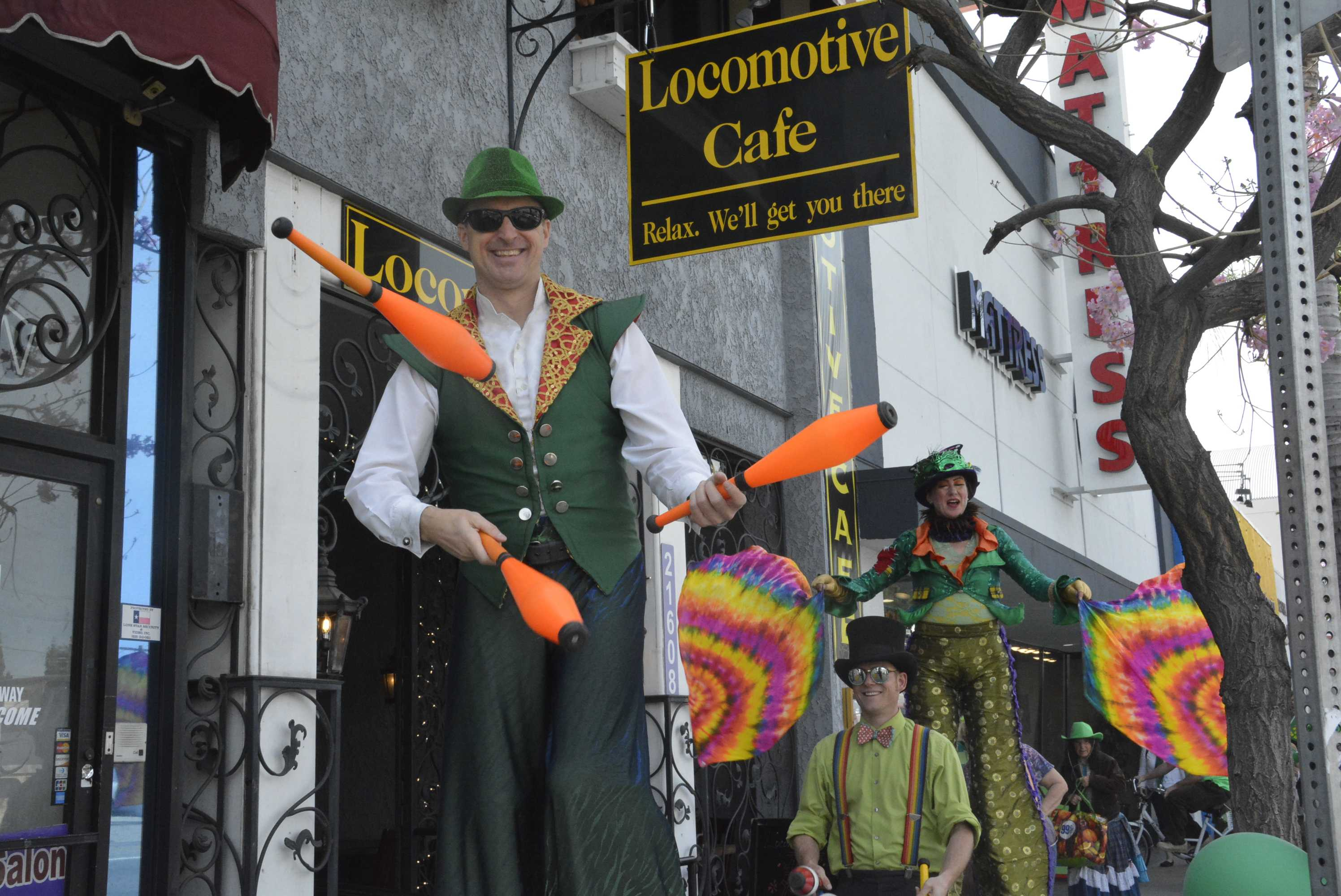 Rob Crites (left), juggler and stilt-walker, performs as he marches with other members in celebration of Irish heritage and St Patrick's Day. Photo credit: Nathalie Ramirez