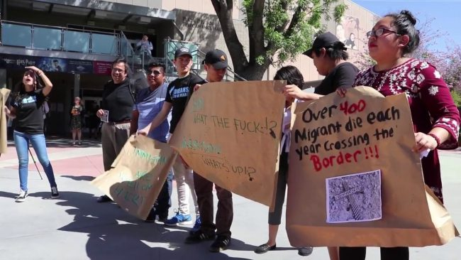 Students pictured protesting customs and border protection