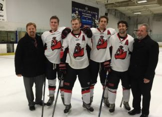 Several members of the matador hockey team pose for a photo on the ice