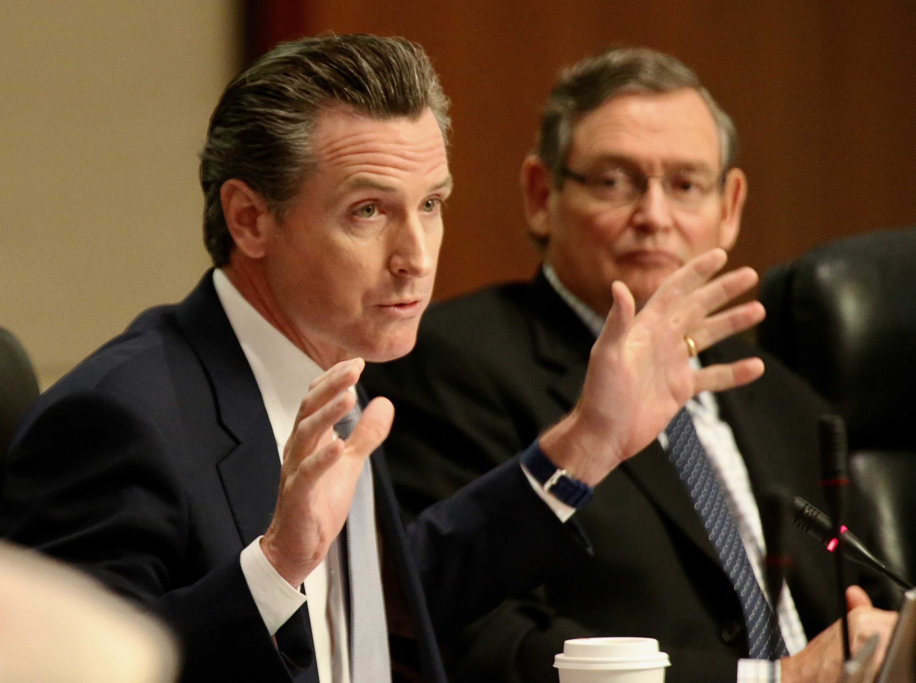 Lt. Gov. Gavin Newsom, left, asks the CSU Board of Trustees to reject the proposed tuition hike Wednesday, March 22, 2017 in Long Beach, Calif. (Iran Khan/Los Angeles Times/TNS)