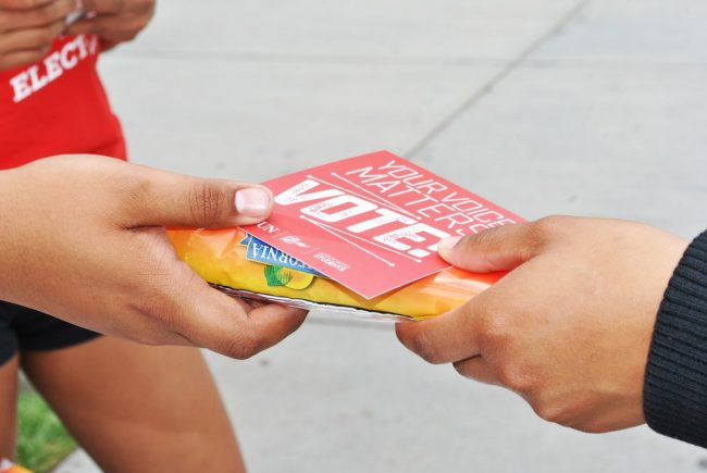 AS committee members stood near the voting stations passing out ice cream and flyers to promote the elections during the April 2016 elections. File Photo: The Sundial