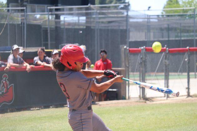 Tara swings at the ball