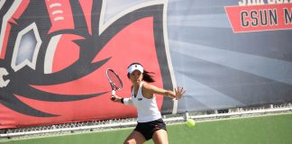 Mickey Hsu looks focused as she prepares to hit the ball