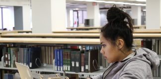 Araceli Uribe pictured studying in the library