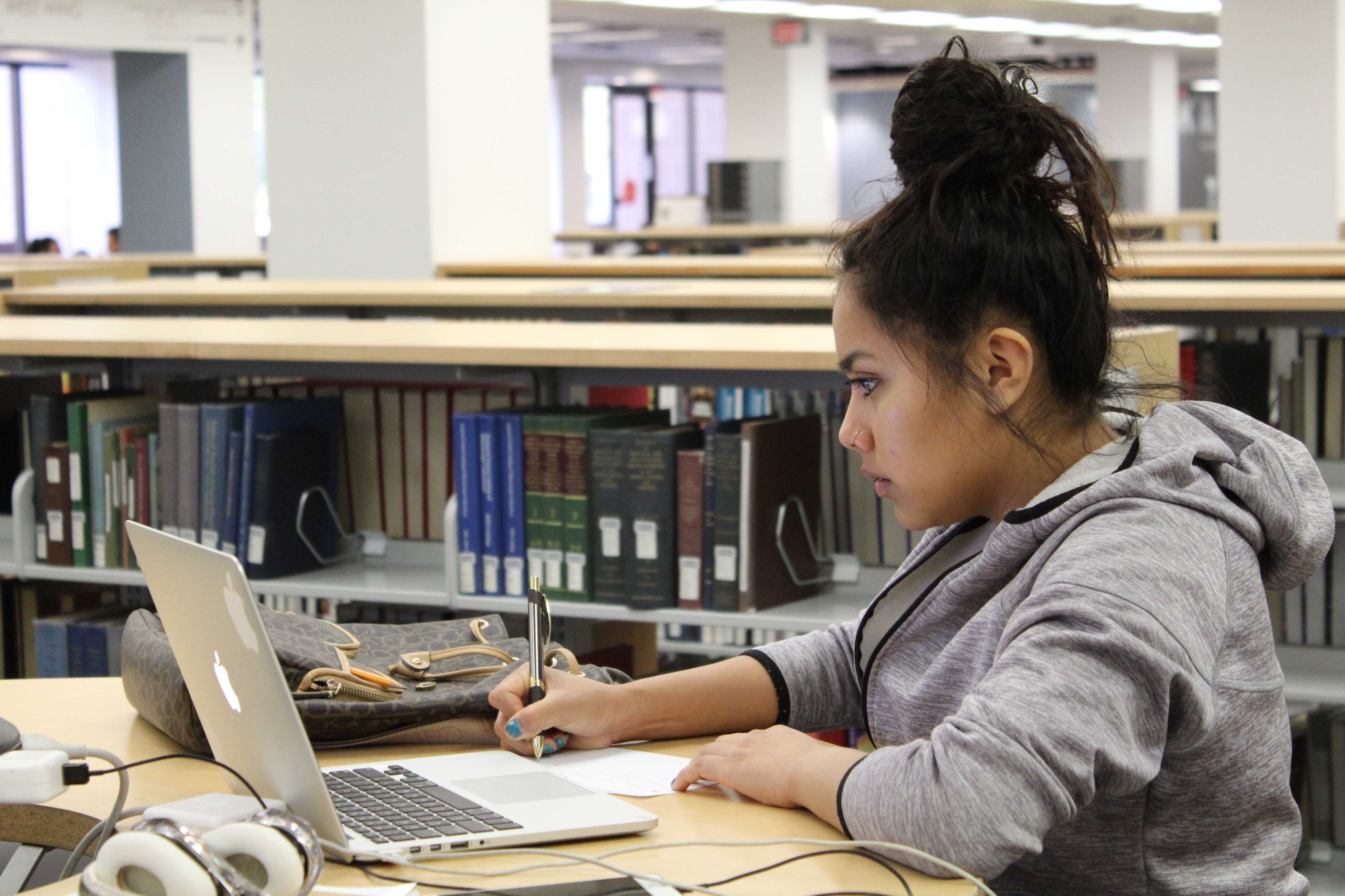 Araceli Uribe, 18 years old and studying Mechanical Engineering here at CSUN, working diligently in the Oviatt Library on Monday April 3rd, 2017. Photo credit: Sofia Scaglione