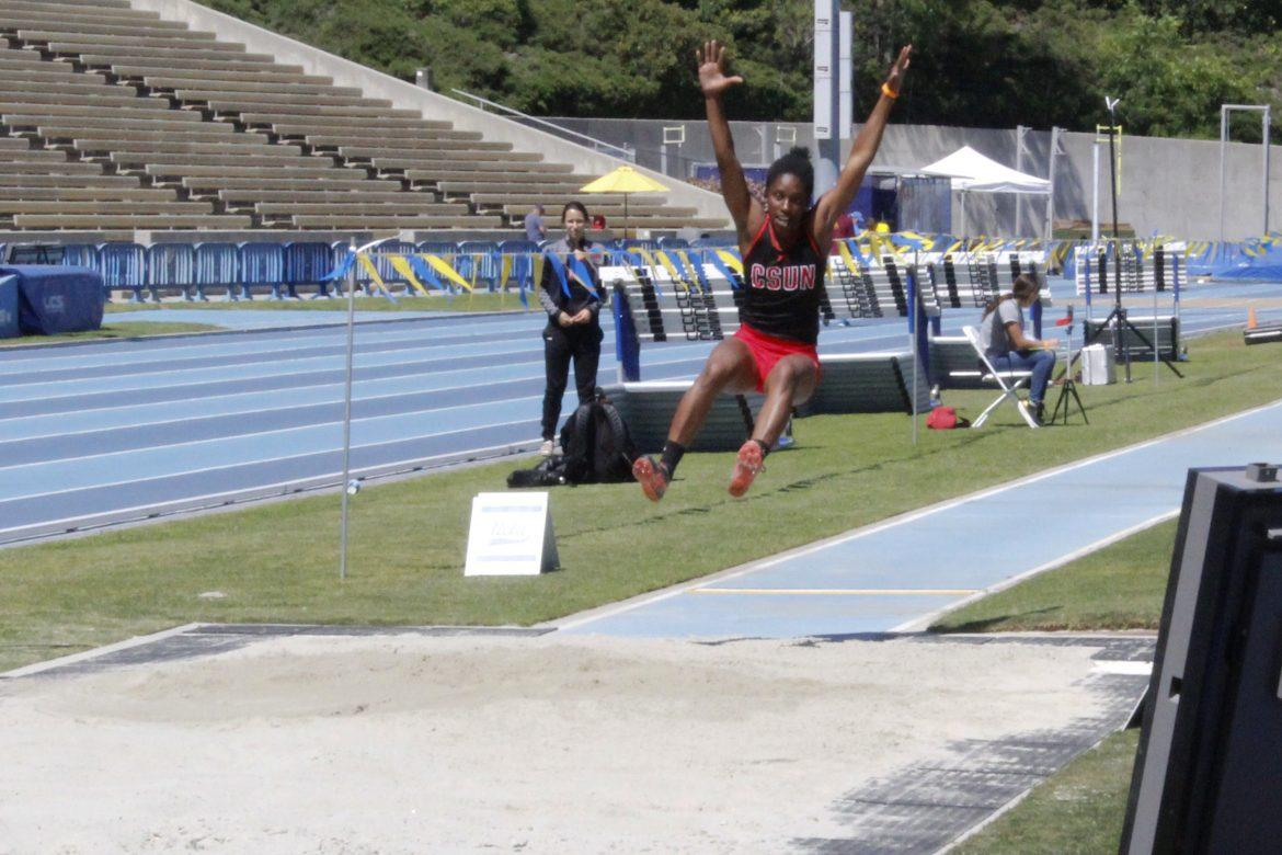 Junior Sydney Berry takes a giant leap during the Women's Long Jump competition at UCLA. Photo credit: Elijah Carr/The Sundial