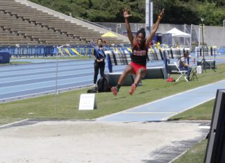 Sydney Berry throws her arms up as she jumps