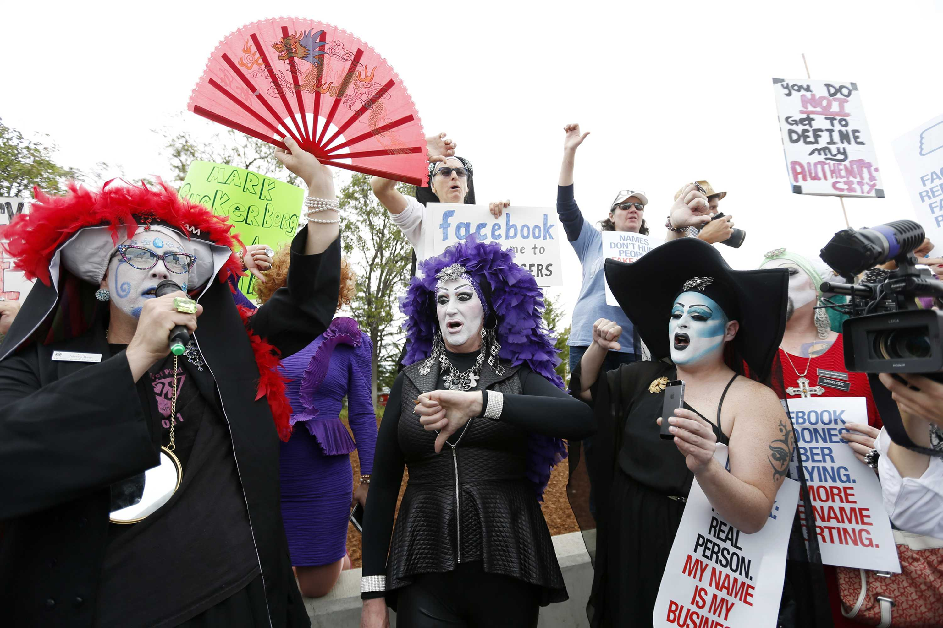 Sister Merry Peter, Sister Roma and Sister Indica, members of the Sisters of Perpetual Indulgence, Inc., give a thumbs down during a protest across from Facebook to protest a rule that requires Facebook users provide their real names on Monday, June 1, 2015, in Menlo Park, Calif. (Josie Lepe/Bay Area News Group/TNS)