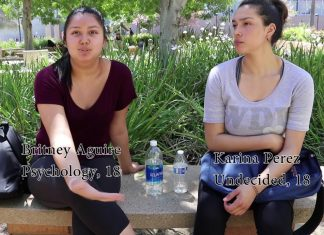 Photo shows Britney Aguire and Karina Perez being interviewed in front of Manzanita hall