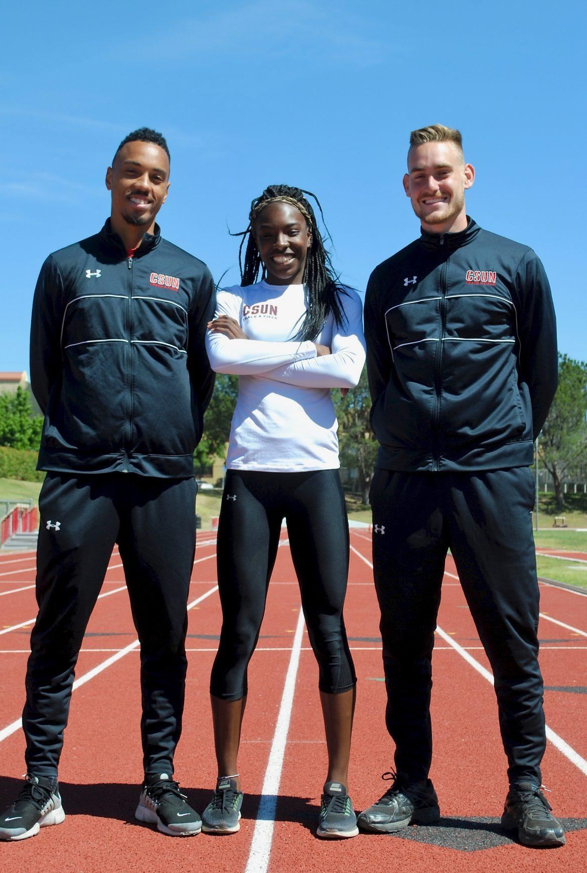 three+student+athletes+pictured+standing+on+the+track