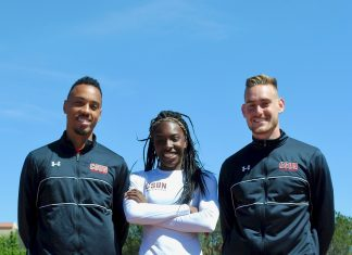 three student athletes pictured standing on the track