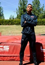 Jackson pictured with a serious expression standing in front of the high-jump mats