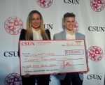students hold up a 20,000 dollar check for their company, sleepy head