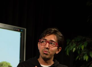 """Karim pictured explaining his book, """"the Great Bangladesh Romantic Comedy"""""""