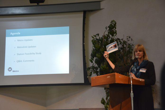 Karen Swift speaks at the podium