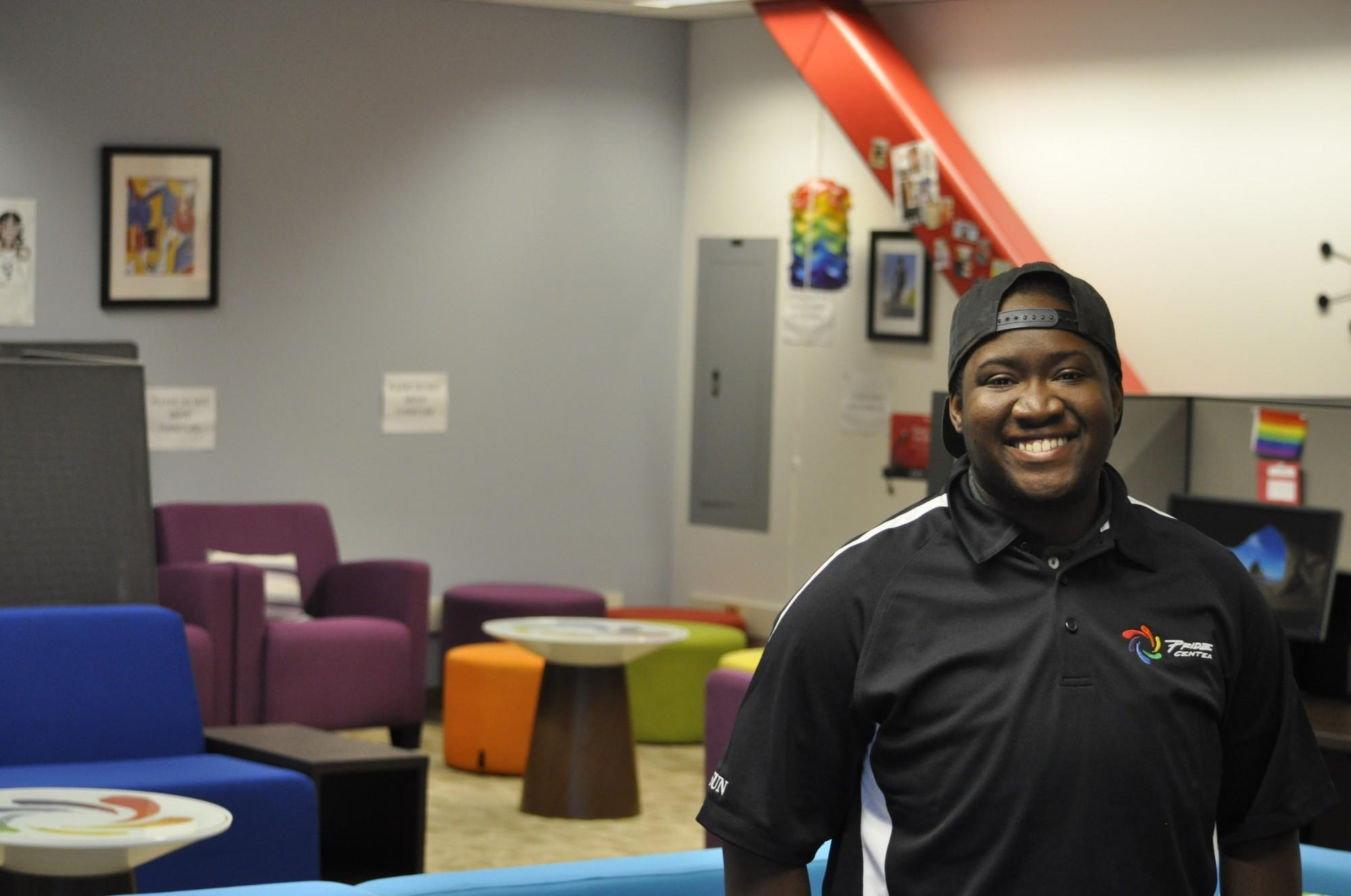 Tyler Neroes pictured standing in the pride center, smiling