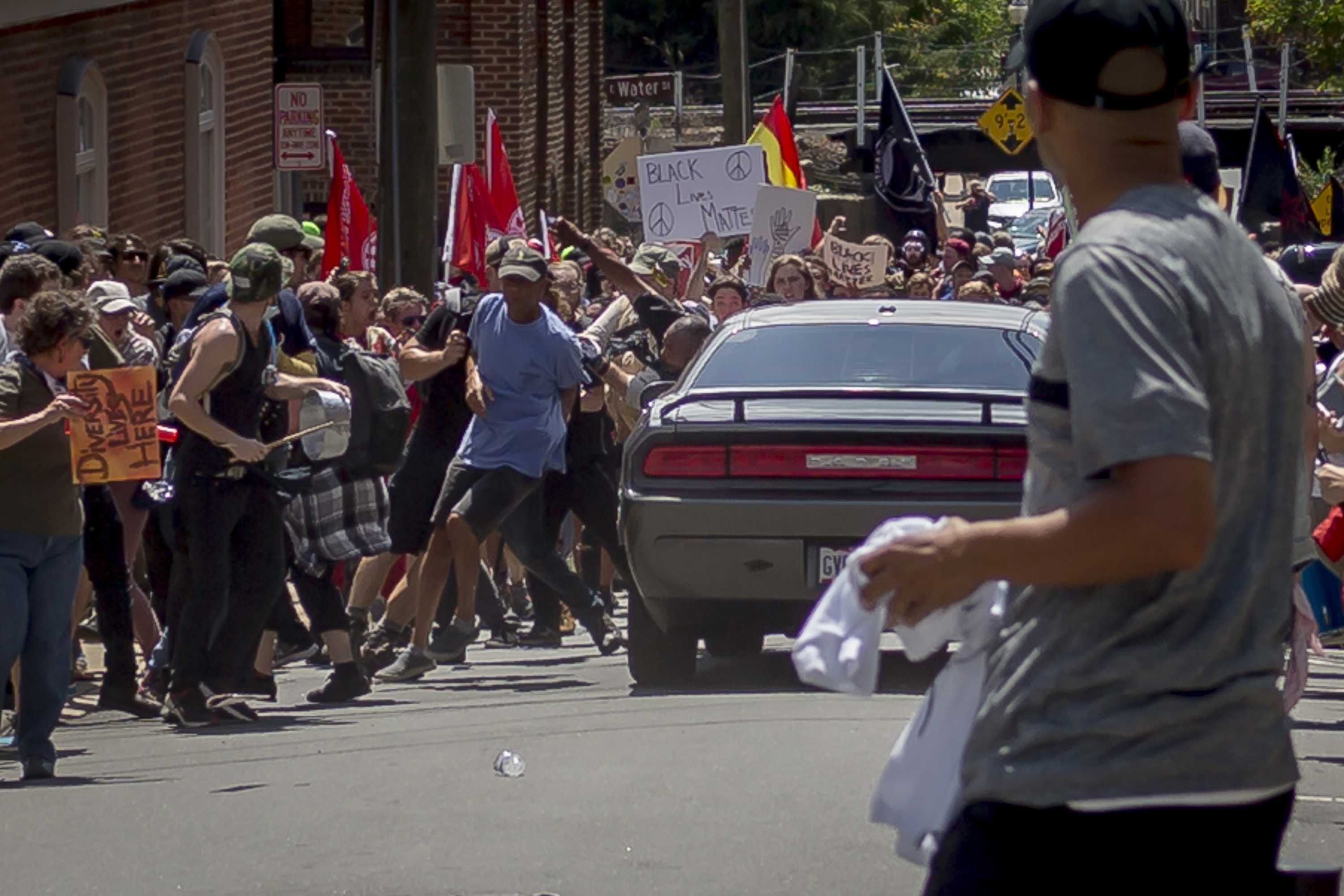 On Saturday, Aug. 12, 2017, white supremacist groups clashed with hundreds of counter-protesters during the ''Unite The Right'' rally in Charlottesville, Va. Dozens were injured in skirmishes and many others after a white nationalist plowed his sports car into a throng of protesters. One counter-protester died after being struck by the vehicle. The driver of the car was caught fleeing the scene and the governor of Virginia issued a state of emergency. (Michael Nigro/Pacific Press/Zuma Press/TNS)