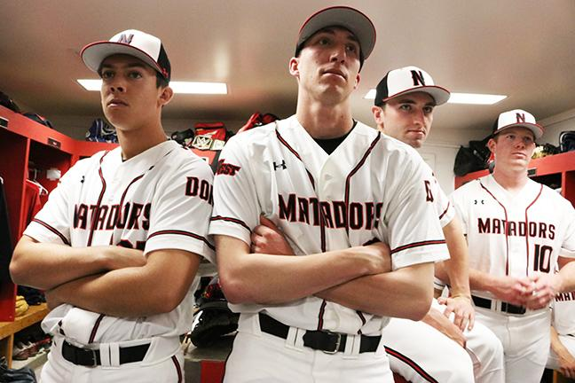 Members of the baseball team listen to their coach give them advice about how to deal with the media during baseball Media Day in the locker room on Tuesday, Jan. 14, 2016. Nikolas Samuels/CSUN