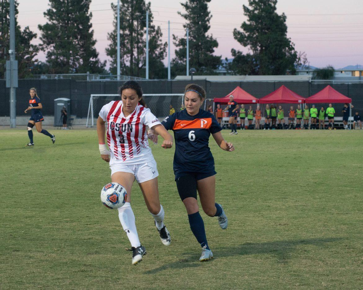 Marissa Favela, left, tries to get possession of the ball from Christina Settles, right, of Pepperdine on Sept. 11. Photo credit: Sundial Alejandro Aranda Photo credit: Alejandro Aranda