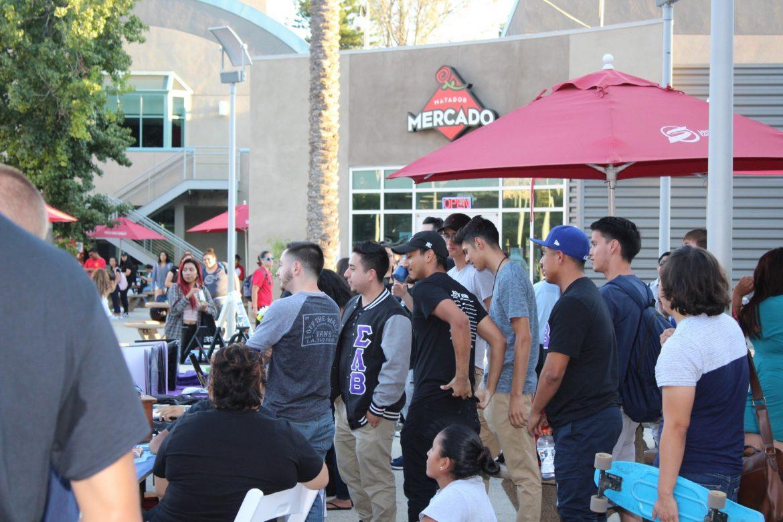 crowd of students gathers around the USU