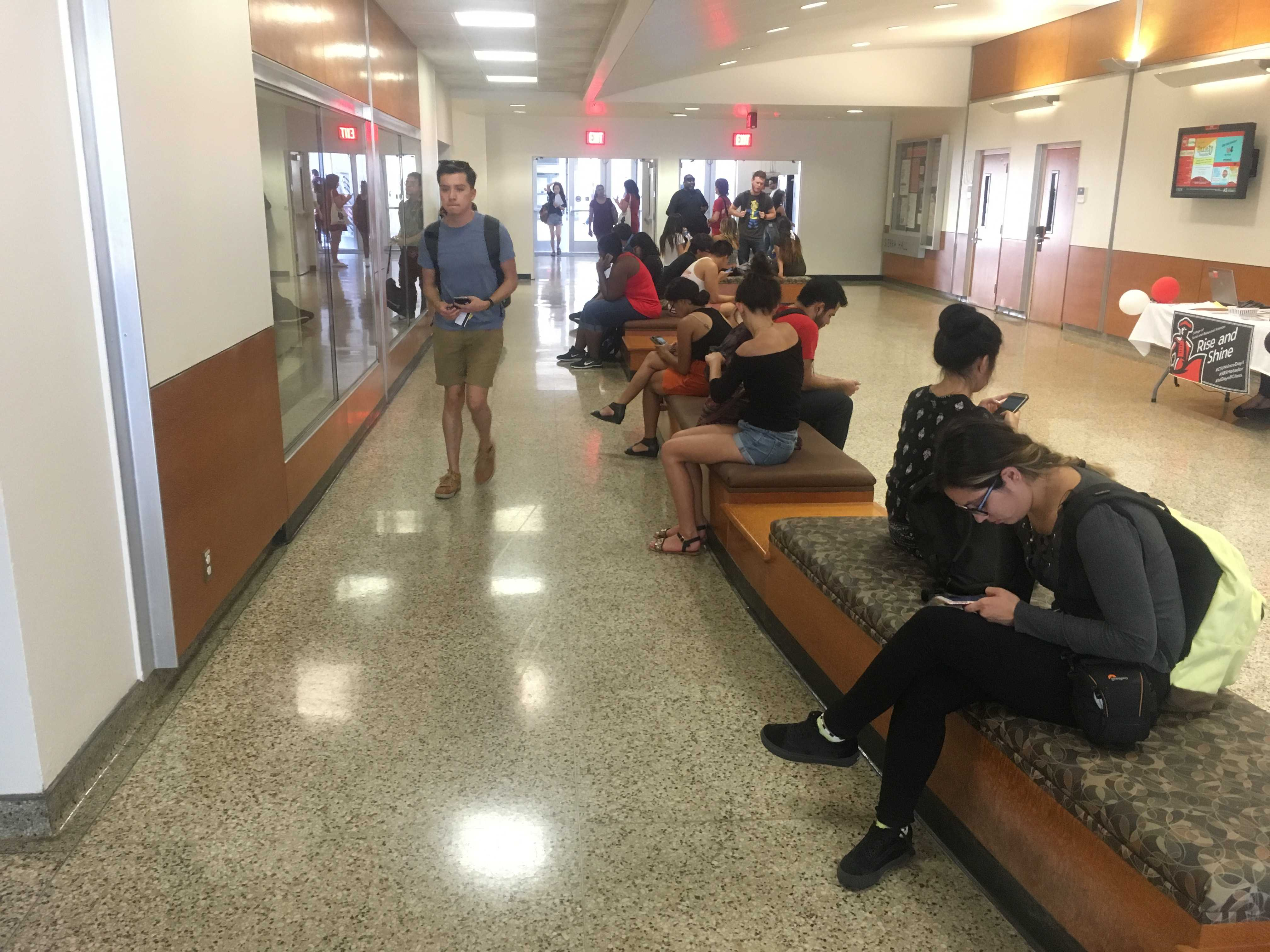 Students hang out inside Sierra Hall in-between classes to momentarily escape the heat Photo credit: Dede Ogbueze