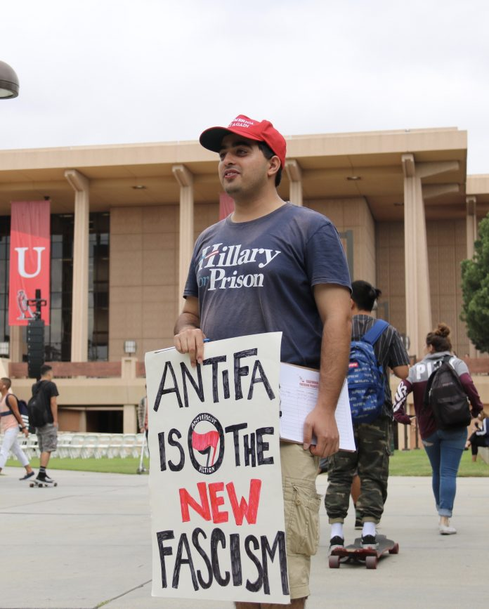 Man pictured on the Oviatt lawn wearing a shirt that says,