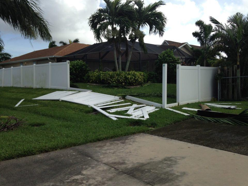 white+fence+knocked+over+on+green+grass