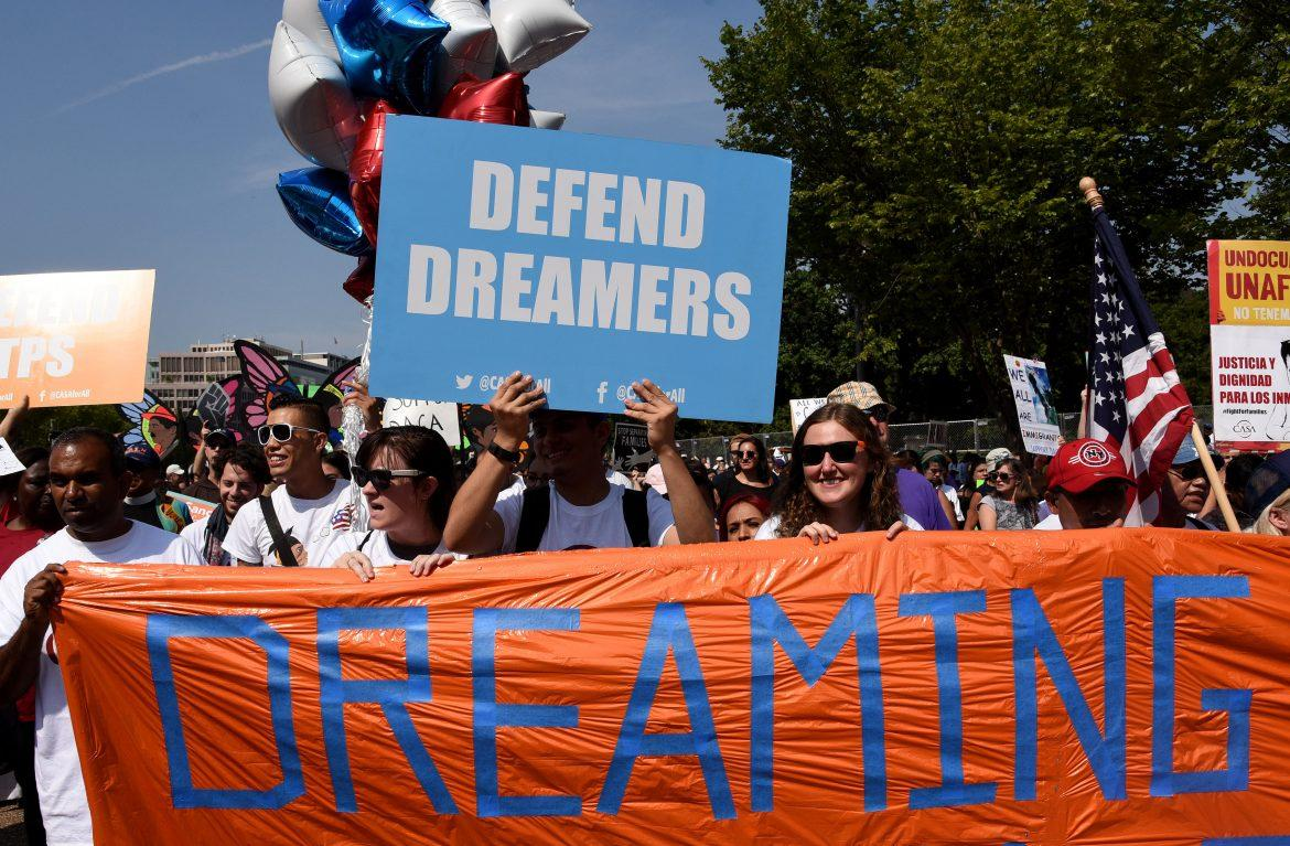 protesters+hold+up+several+signs%2C+on+of+them+which+reads%2C+%22dreaming%22+and+another+says%2C+%22defend+dreamers%22