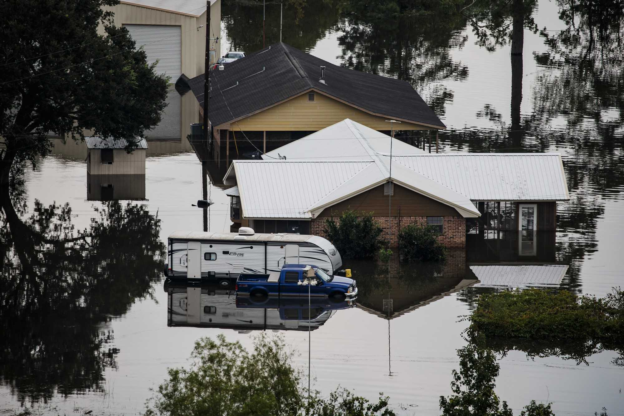 Rising floodwater engulfs entire residential neighborhoods in the aftermath of Tropical Storm Harvey near Lumberton, Texas, on Thursday, Aug. 31, 2017. (Marcus Yam/Los Angeles Times/TNS)