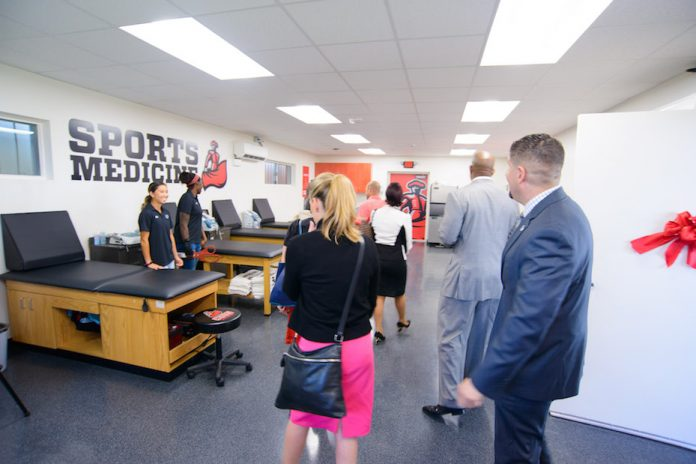 men and women look at new facility
