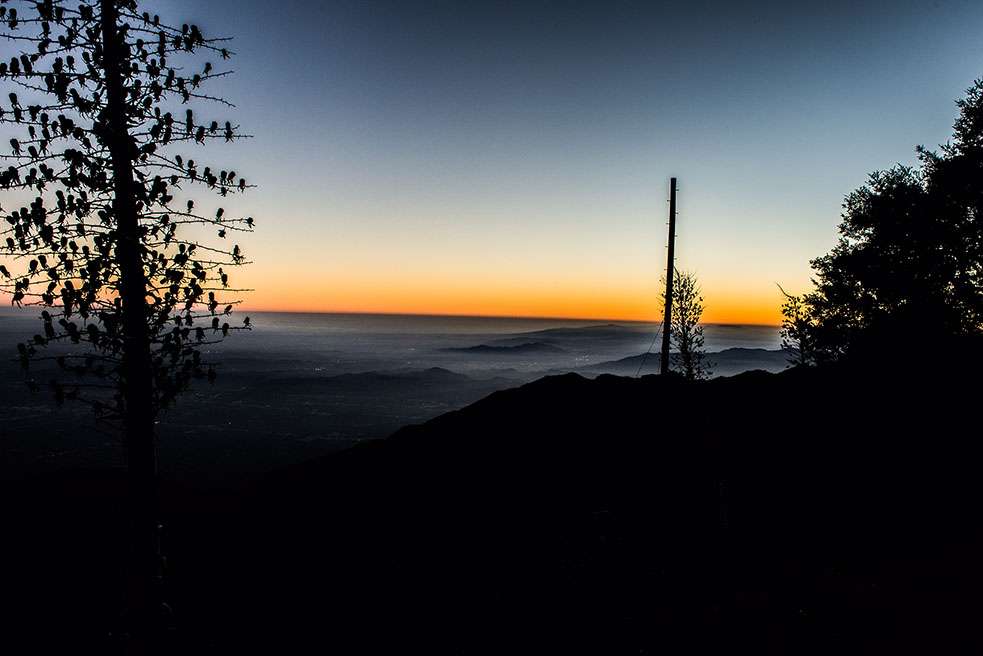 Photo of a sunset on top of a mountain