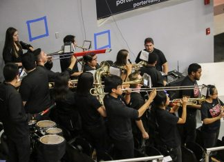 band performing all wearing black