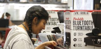 girl in grey shirt looking at records