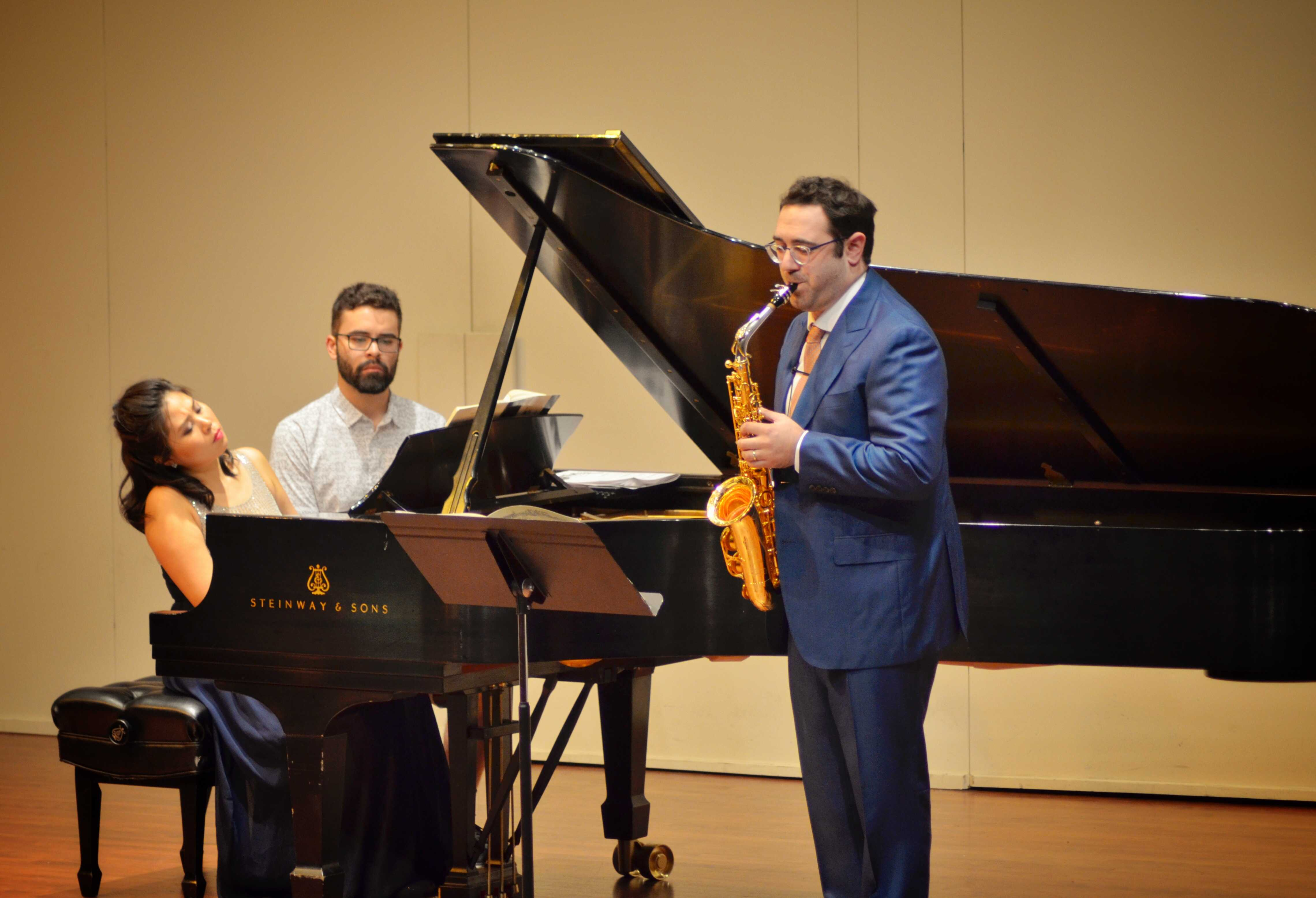 Dr. Benjamin Sorrell (right) and pianist Akina Motoyama (left) with assistant playing at the Cypress Recital Hall. 10/22/2017 Photo credit: Nick Rose