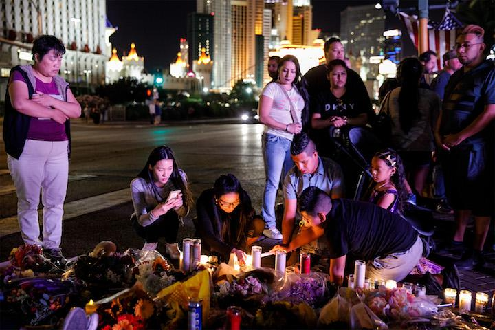 People+visit+and+pay+their+respects+at+a+makeshift+memorial+for+the+victims+of+the+recent+mass+shooting%2C+on+Reno+Ave+and+Las+Vegas+Blvd.+on+Oct.+3%2C+2017+in+Las+Vegas.+%28Marcus+Yam+%2F+Los+Angeles+Times%2FTNS%29