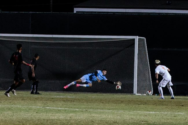 CSUN goalie in blue tries to stop a ball