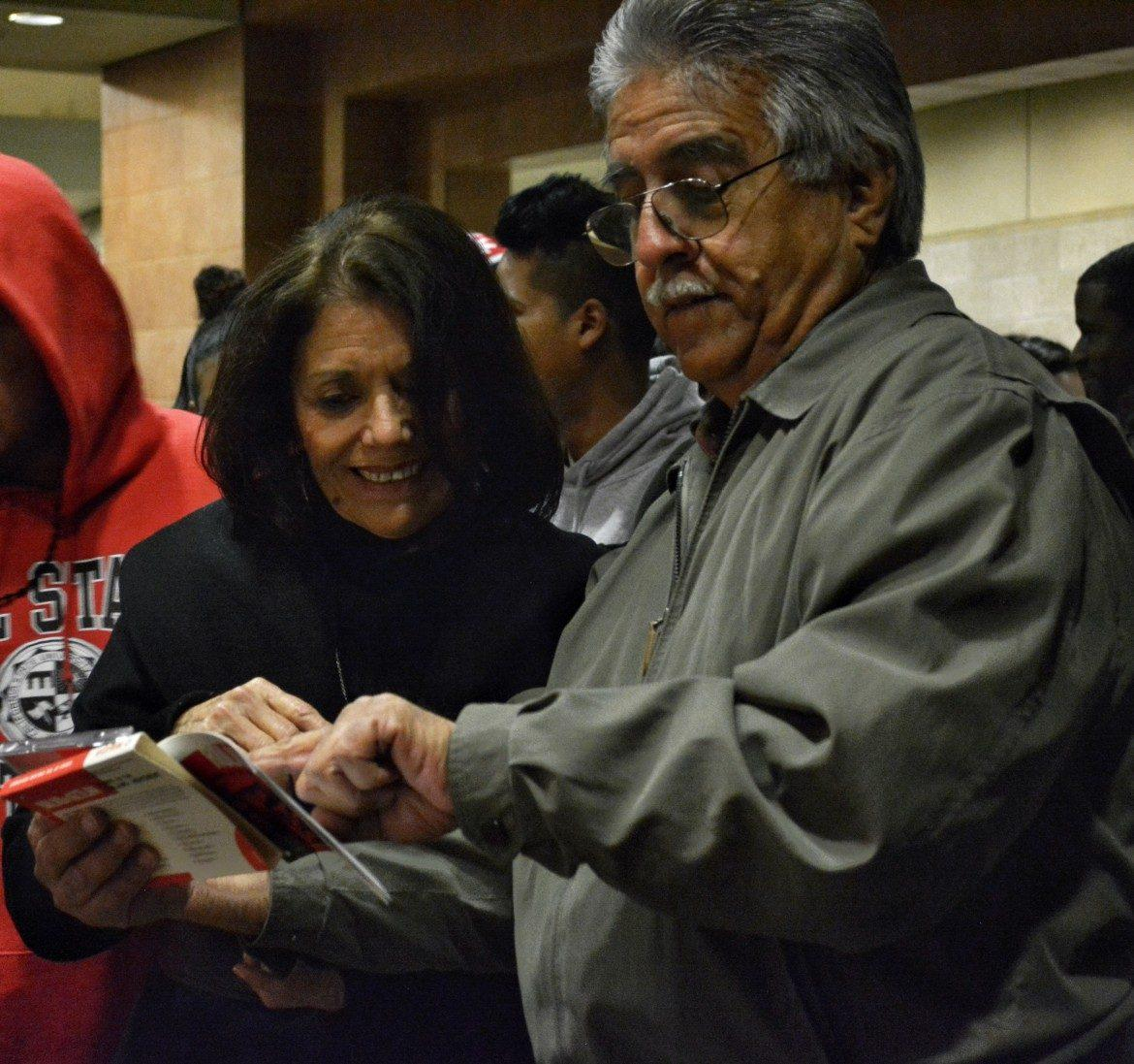 Shiva Parsa (left), Associate Director of EOP, and Veto Ruiz (right), a Chicano studies professor, sharing memories of Vargas on March 31, 2016. Photo credit: Patricia Perdomo
