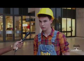 man dressed as Bob The Builder being interviewed