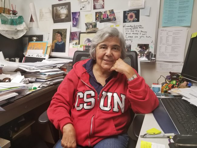 woman in red CSUN jacket smiling
